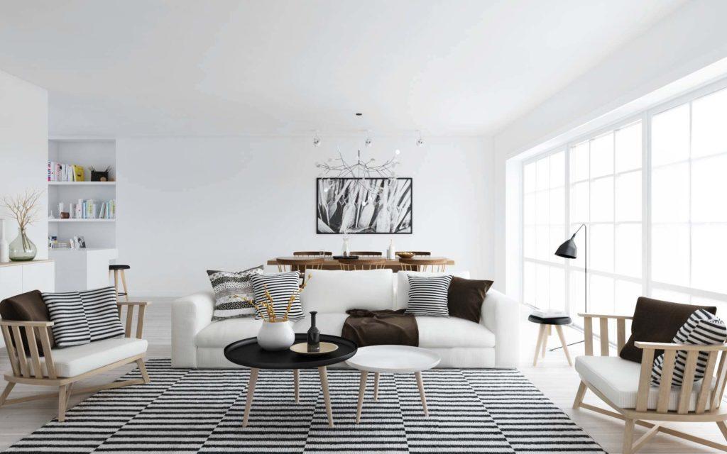 Просторная гостиная в скандинавском стиле с ковром и декоративными подушками в полоску