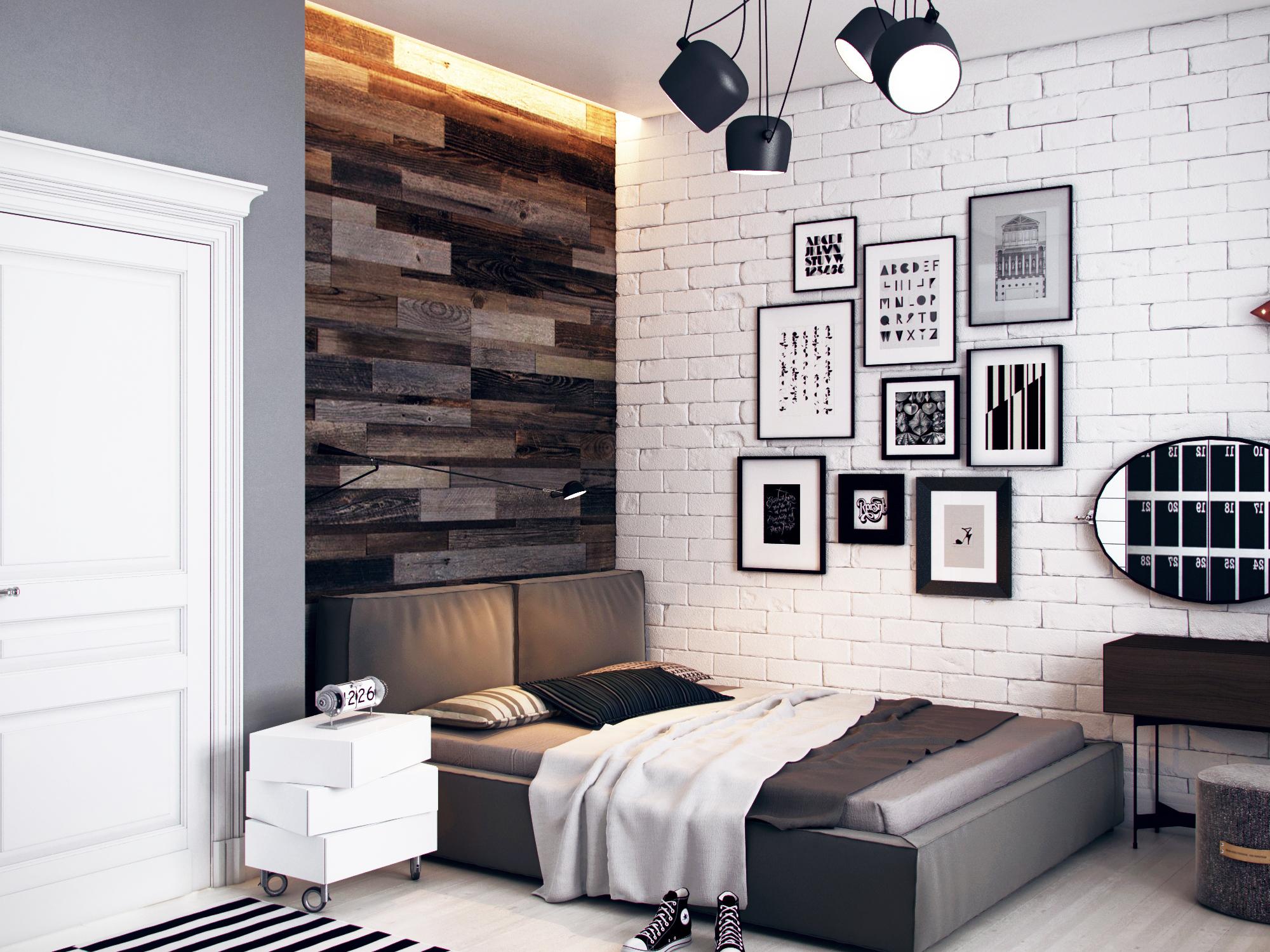 Черно-белые картины на кирпичной стене в спальне