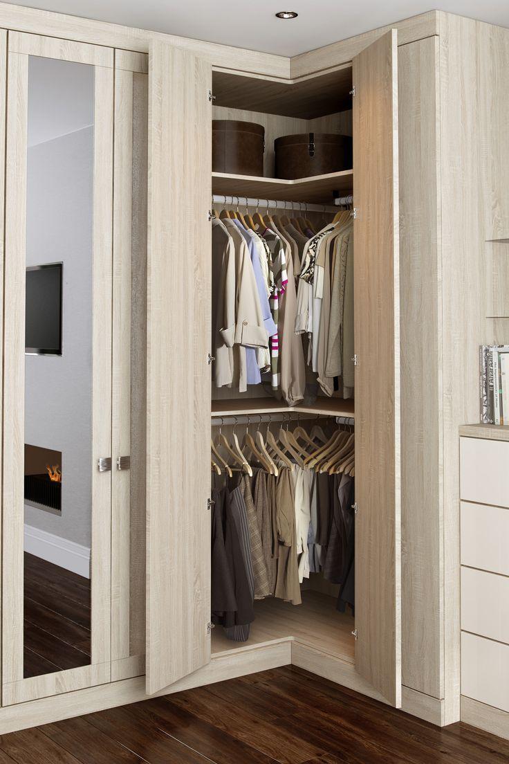 Угловой шкаф маленький в интерьере спальни