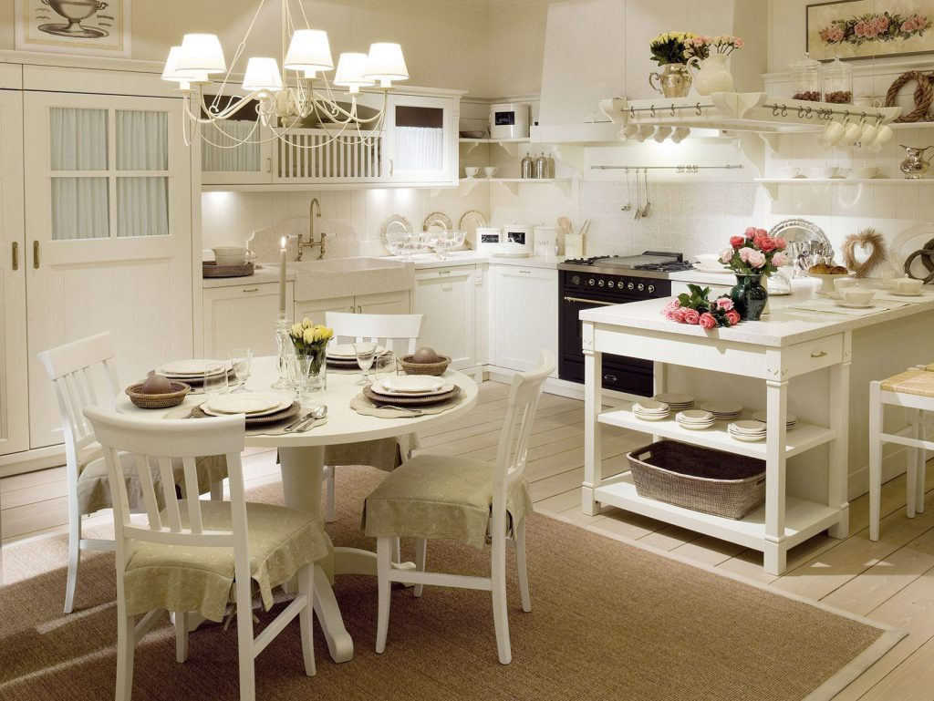 Круглый белый деревянный стол на кухне