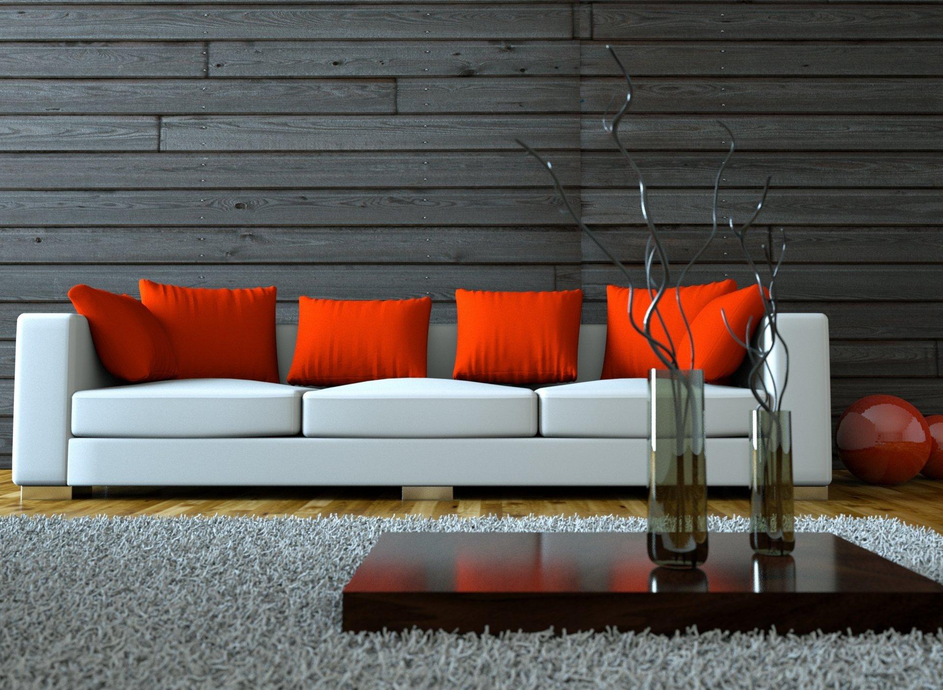 Яркие оранжевые подушки на светлом диване
