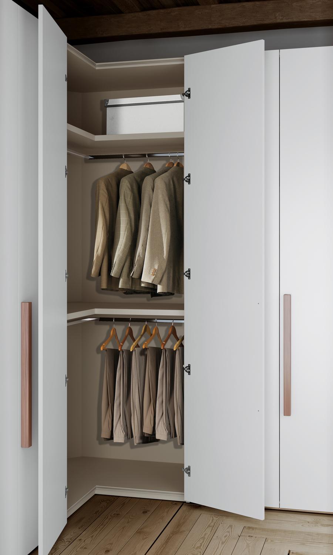 Угловой шкаф в интерьере спальни распашной