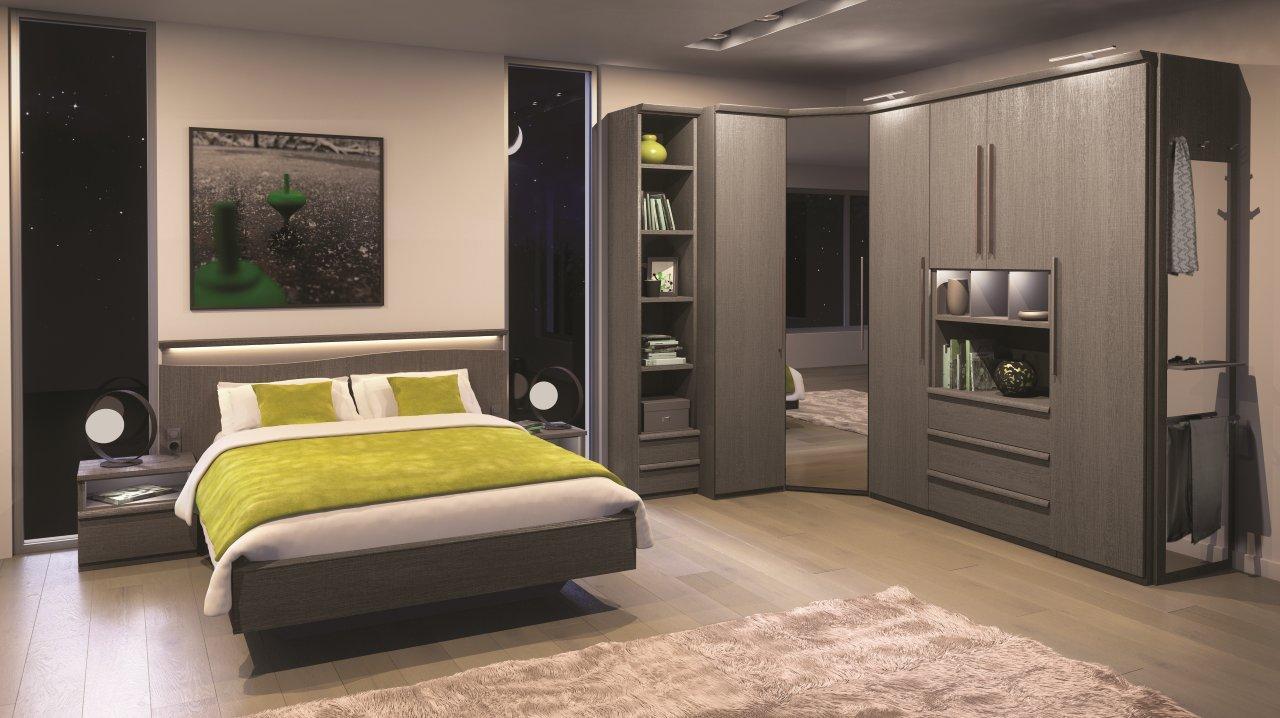 Угловой шкаф в интерьере спальни серый