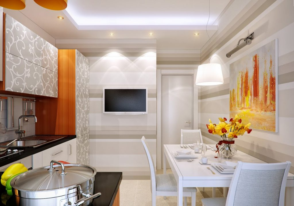 Белый телевизор в оранжево-белой кухне