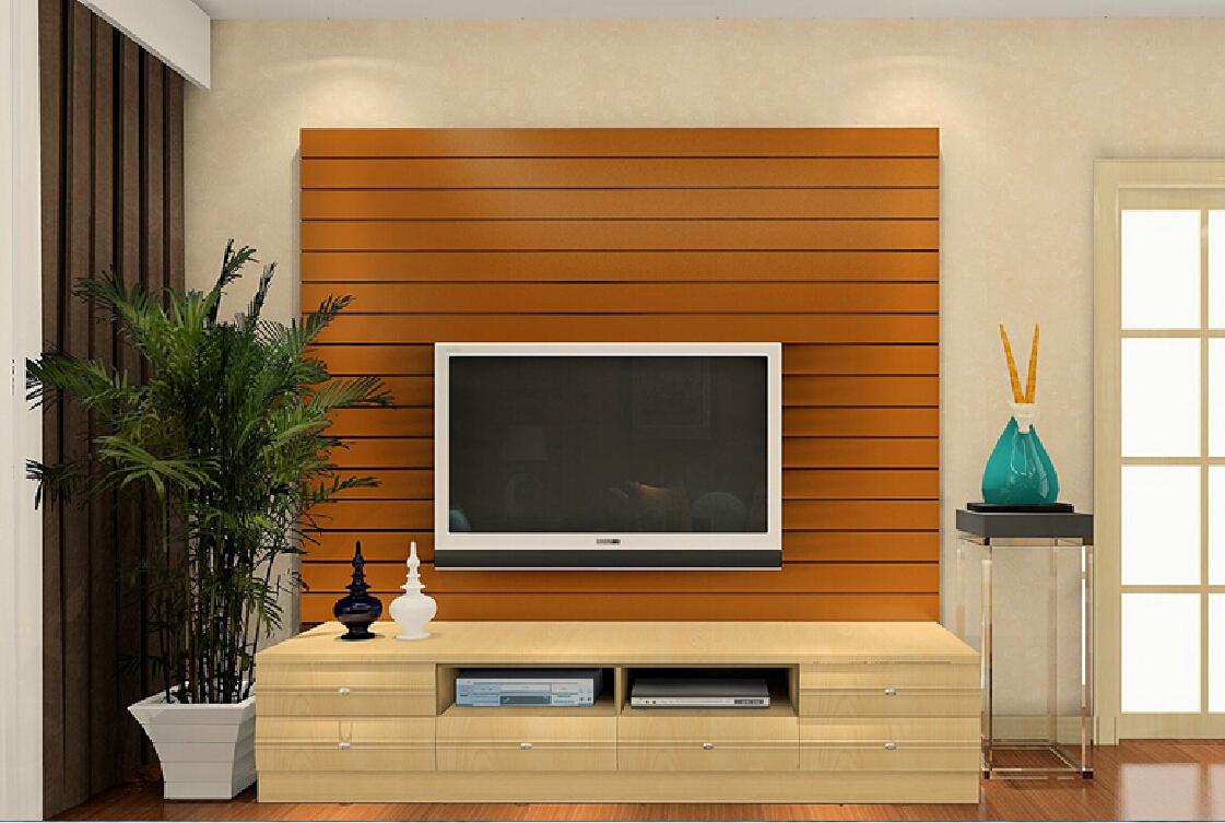 Телевизор на фоне декоративной стены