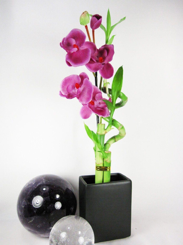 Красивое сочетание бамбука и орхидеи для украшения интерьера