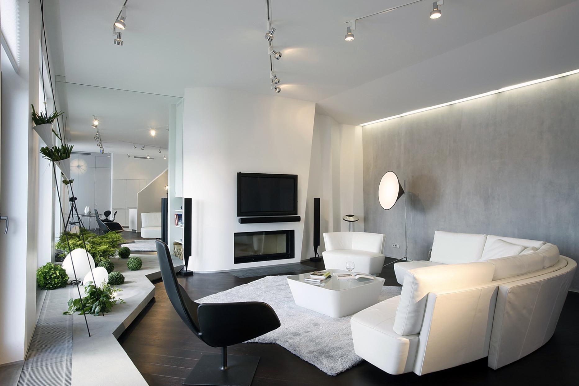 Бело-серая гостиная с черными акцентами в скандинавском стиле