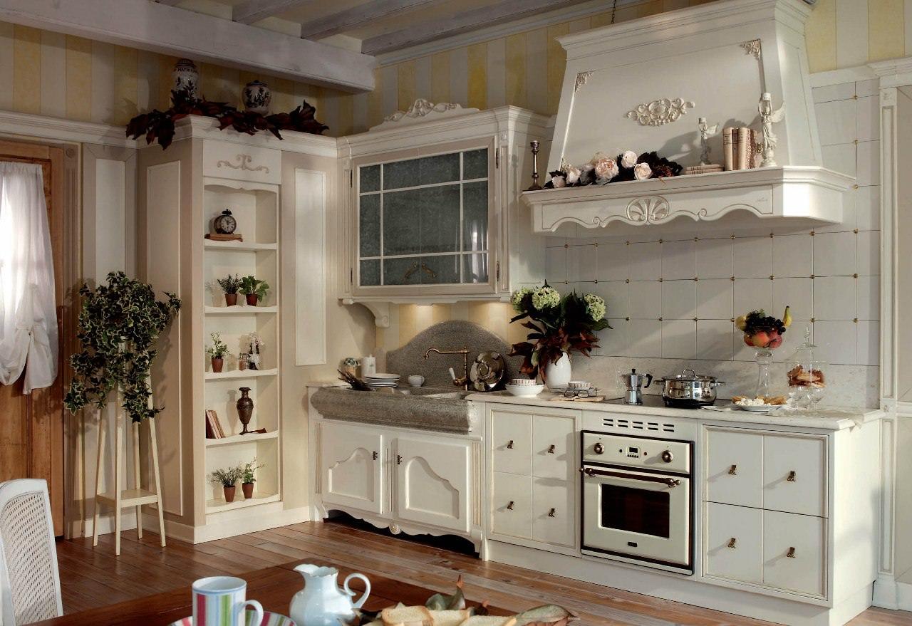 Каминная купольная вытяжка на кухне в стиле прованс