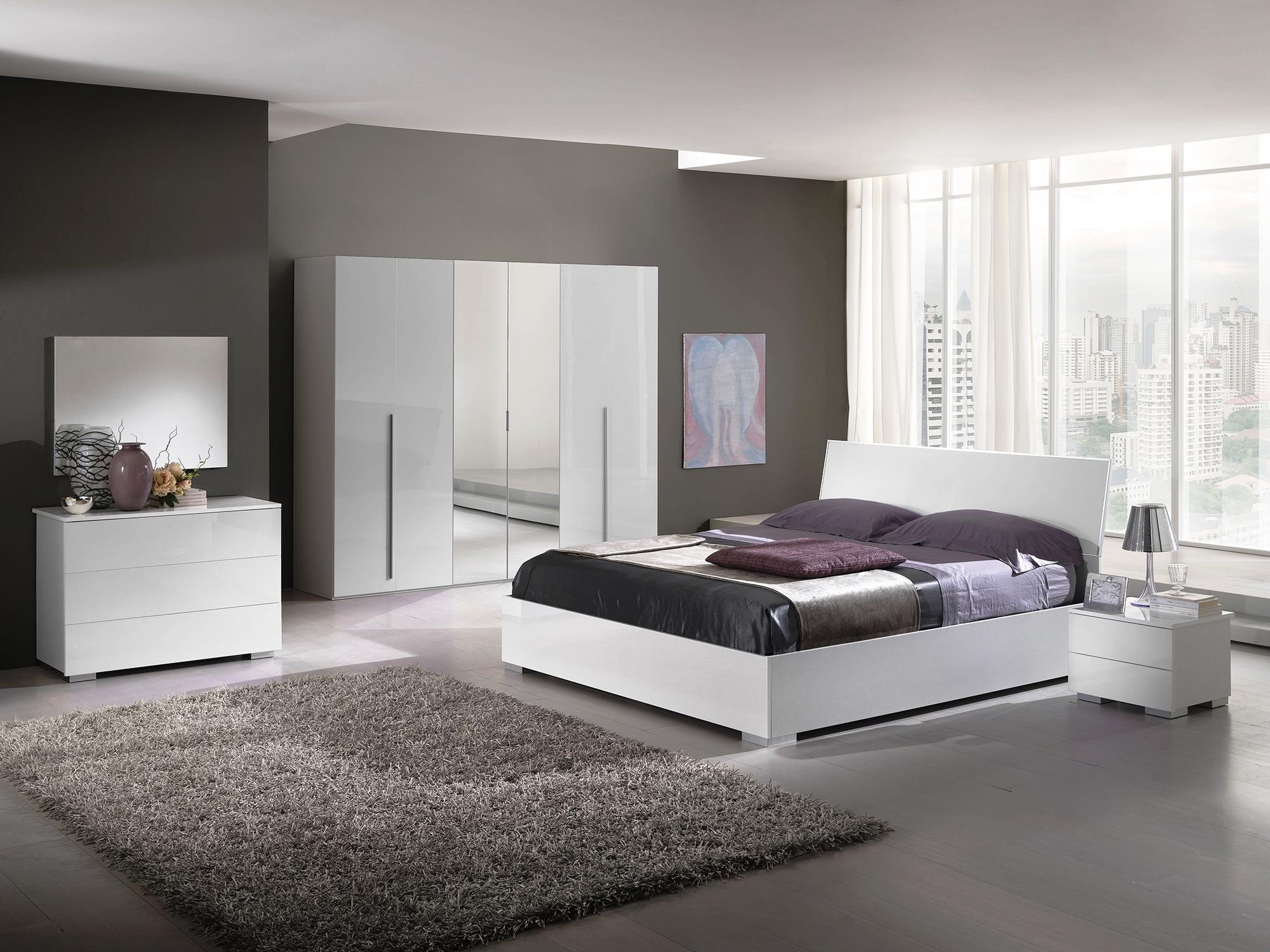 Серо-белый интерьер спальни в стиле модерн