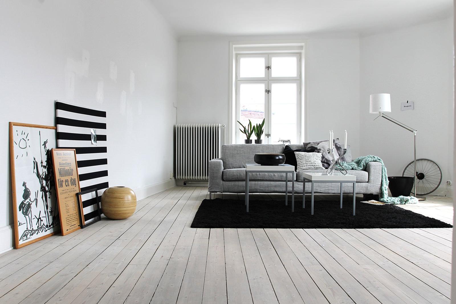 Серый, белый и черный цвета в интерьере гостиной