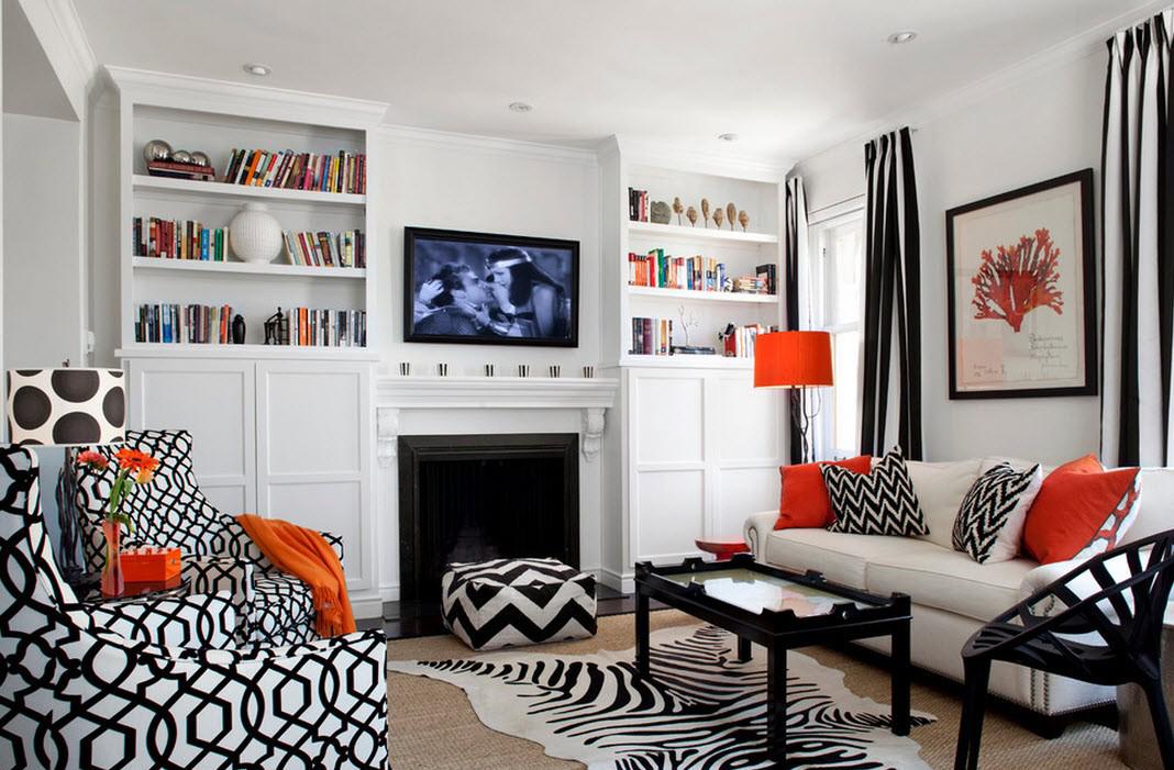 Оранжевые акценты в уютной черно-белой гостиной