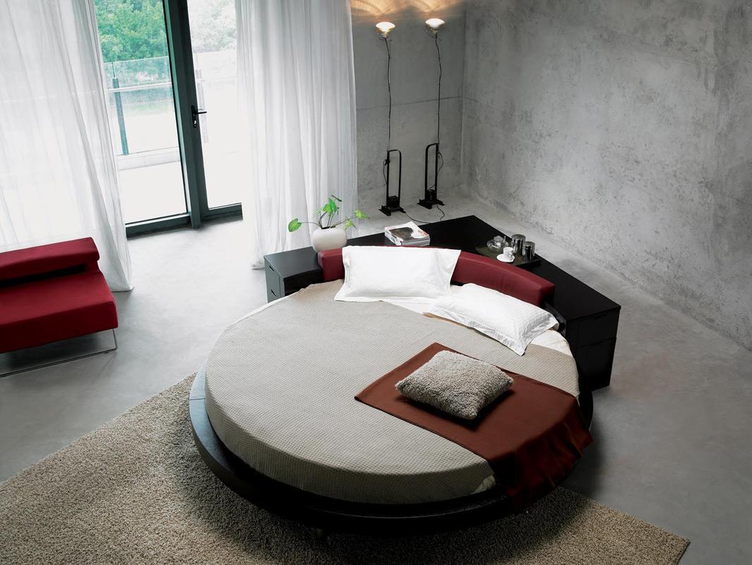 Черная круглая кровать с угловой тумбой