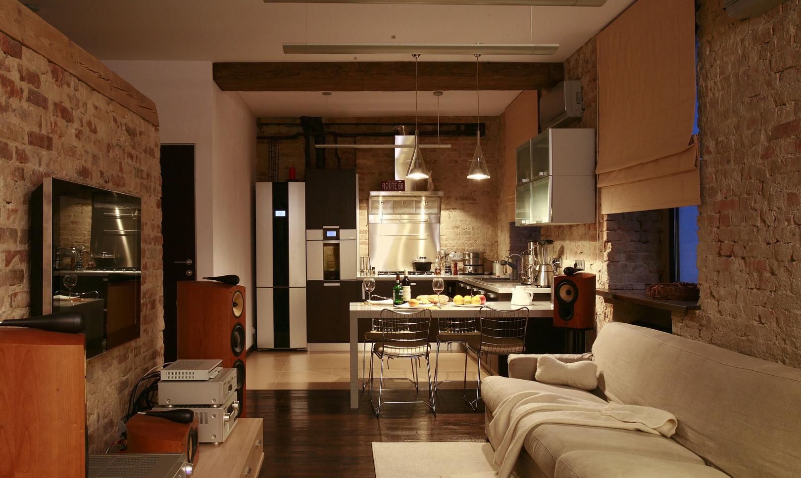 Кирпичные стены в гостиной-кухне в стиле лофт