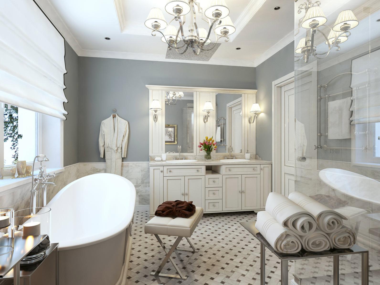 Белая мебель в классической ванной