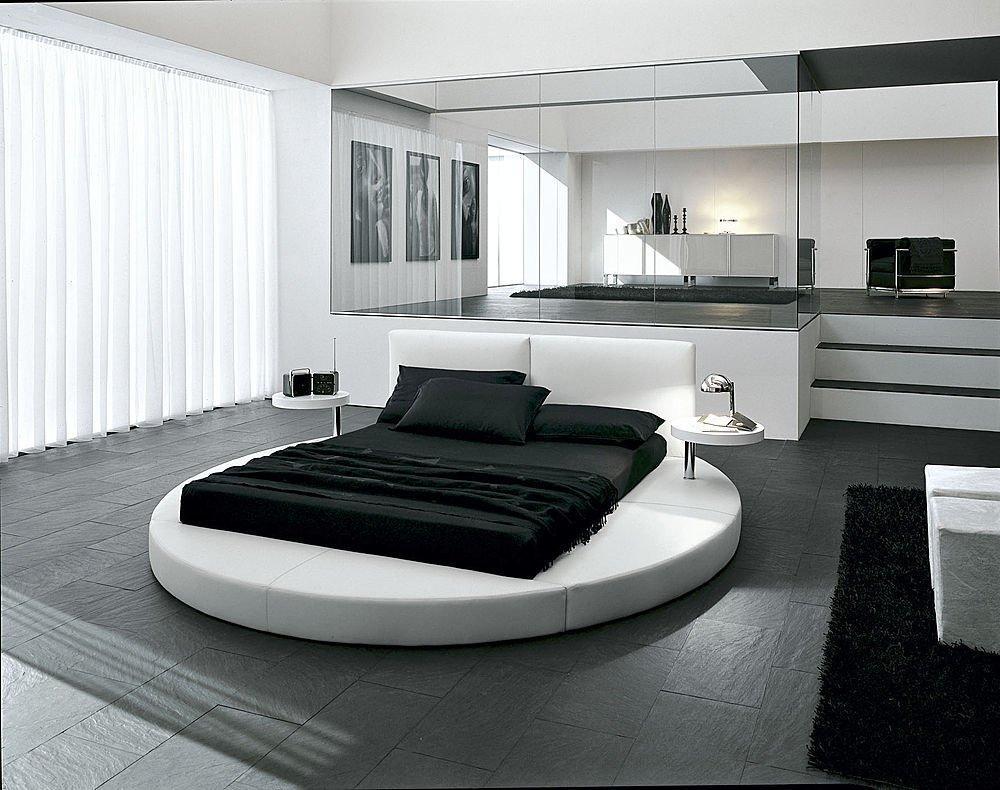 Круглая кровать в черно-белой спальне в стиле хай-тек