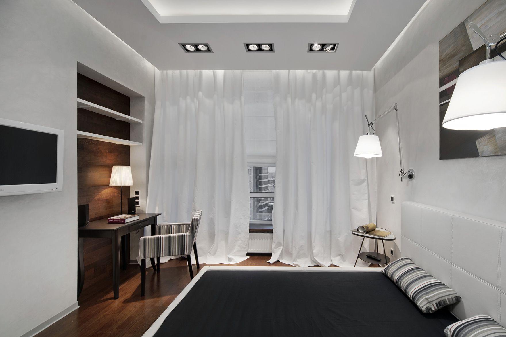 Черно-белая спальня с рабочим местом