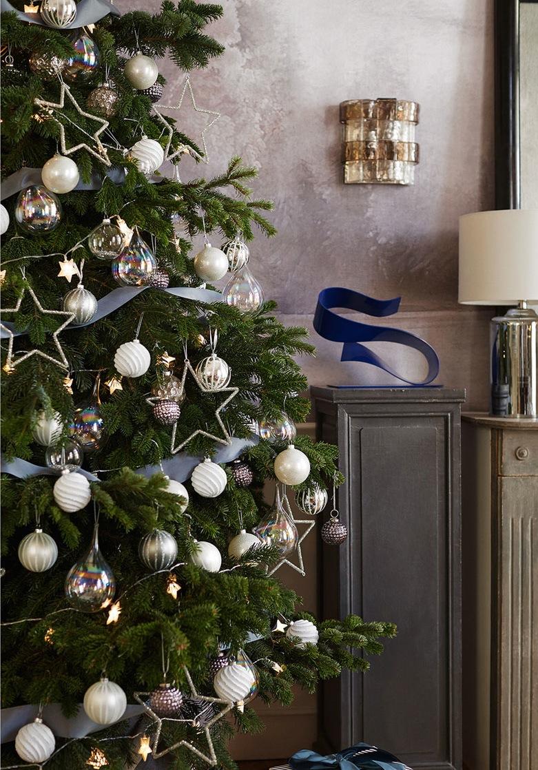 Оформление новогодней елки звездами