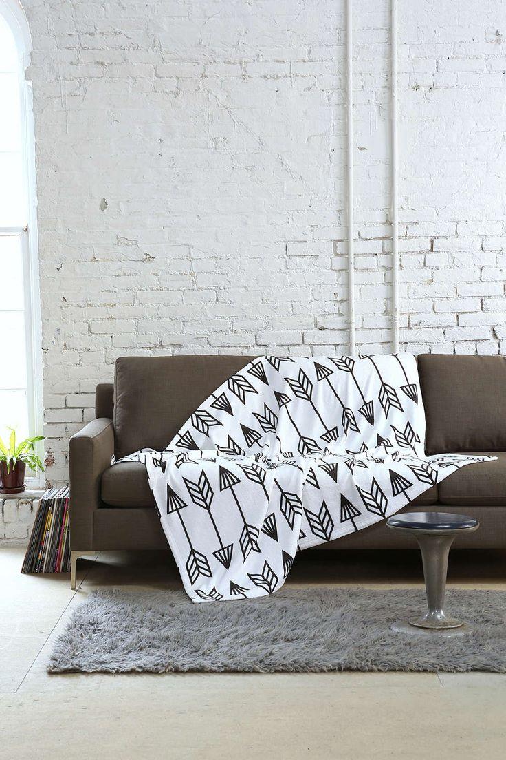 Коричневый диван еврокнижка в светлой гостиной