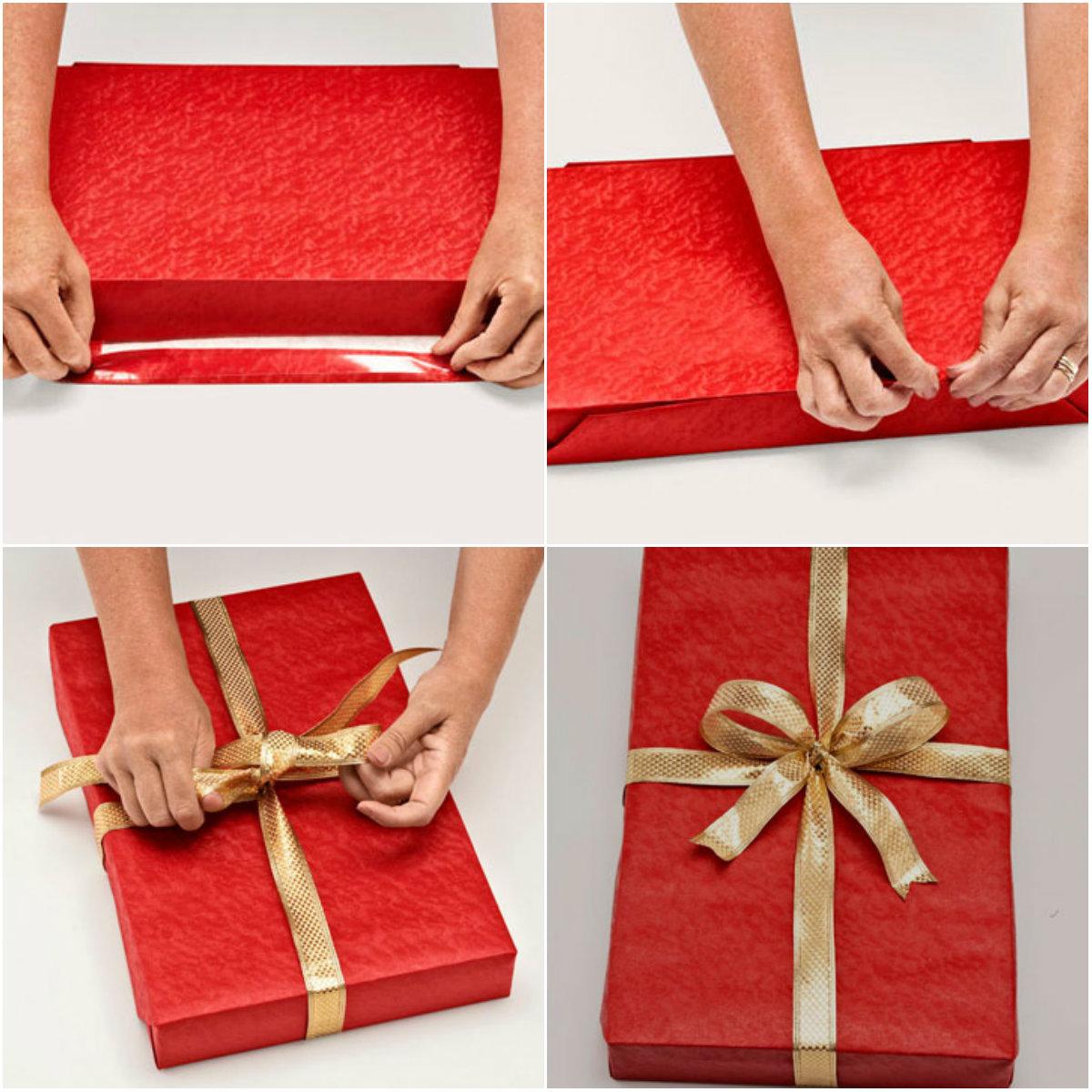 Упаковка подарка в красную бумагу и золотистую ленту