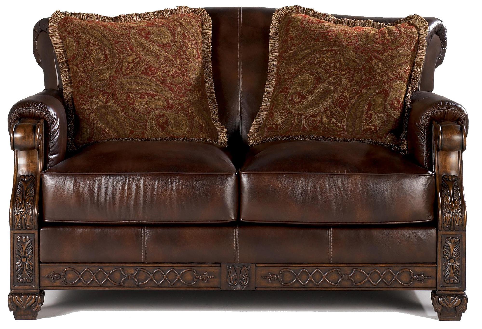 Кожаный диван с резным деревянным декором