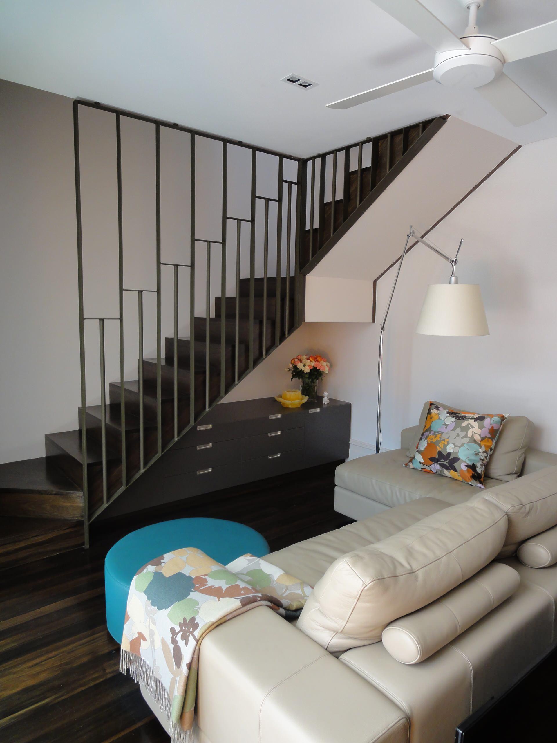 Комод под лестницей в гостиной