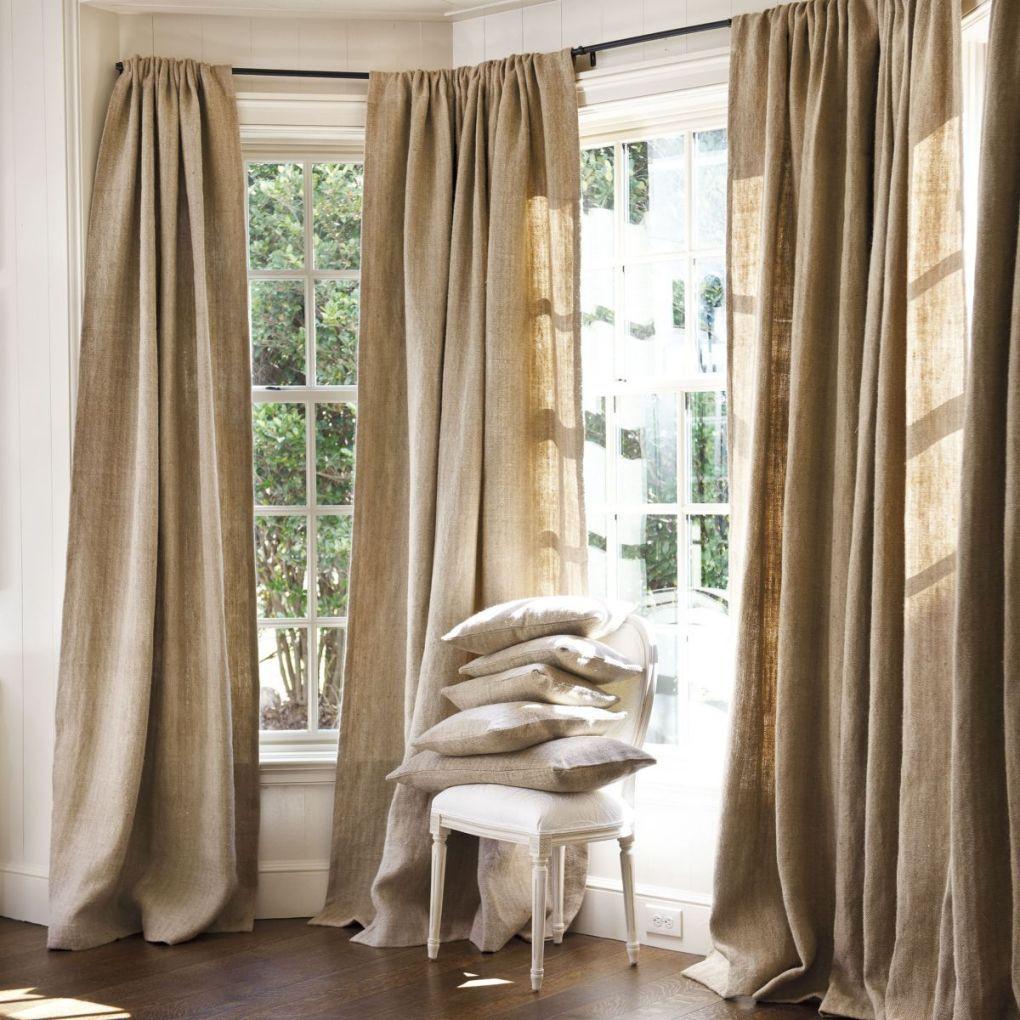 Плотные льняные шторы в интерьере