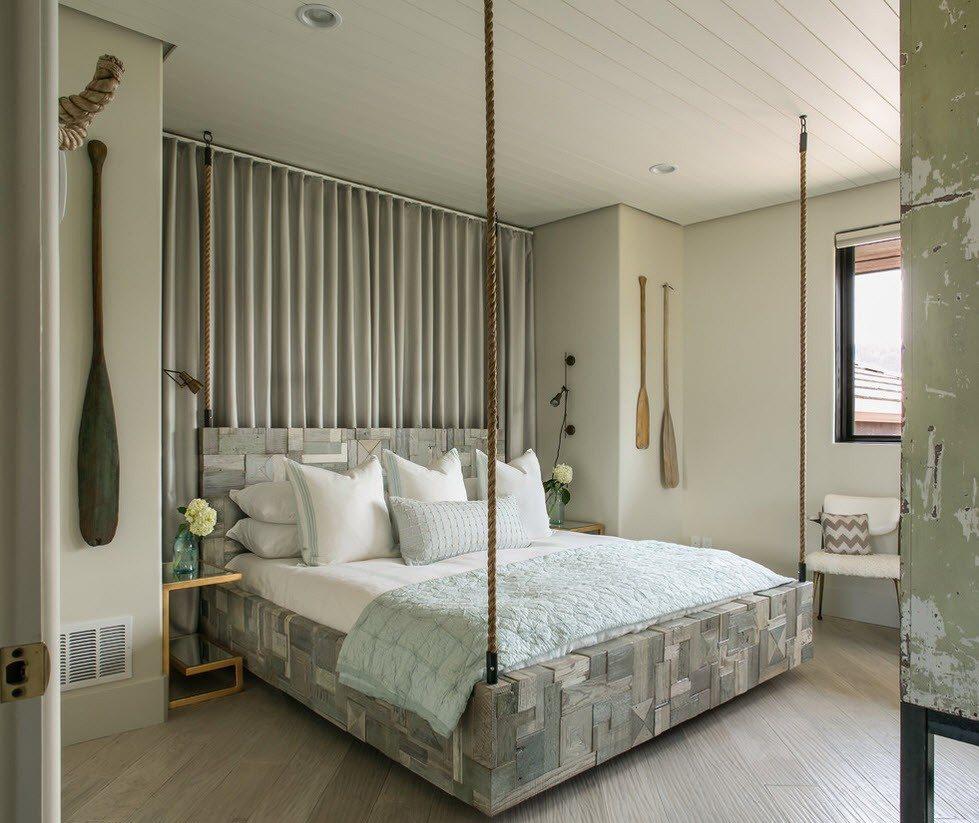 Подвесная серая кровать в спальне