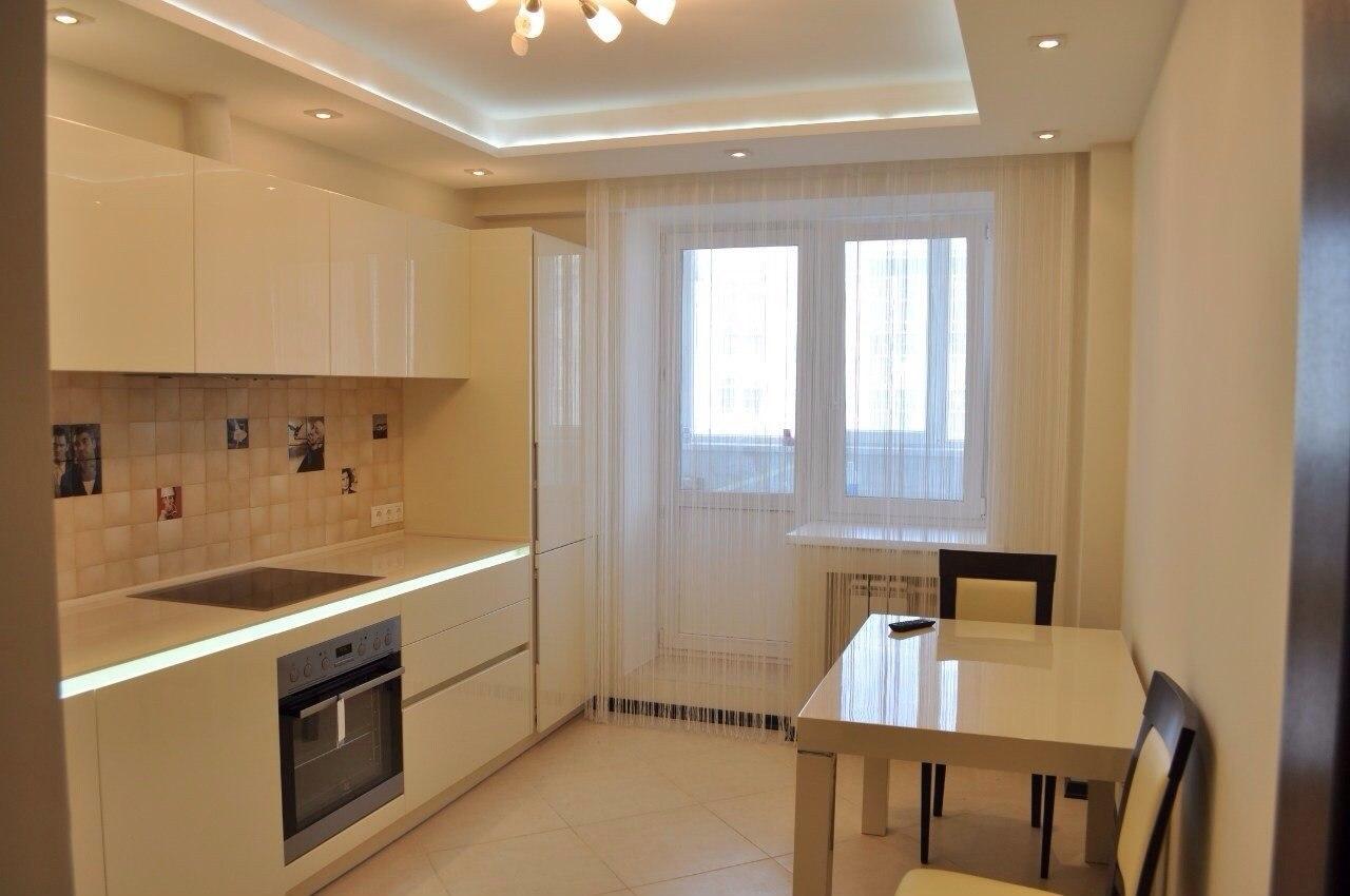 Двухуровневый потолок с подсветкой из гипсокартона в кухне