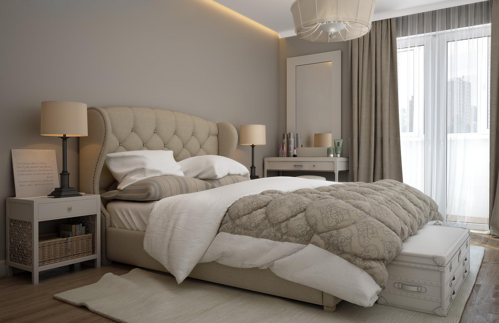 Бежевая кровать и тумбы в спальне