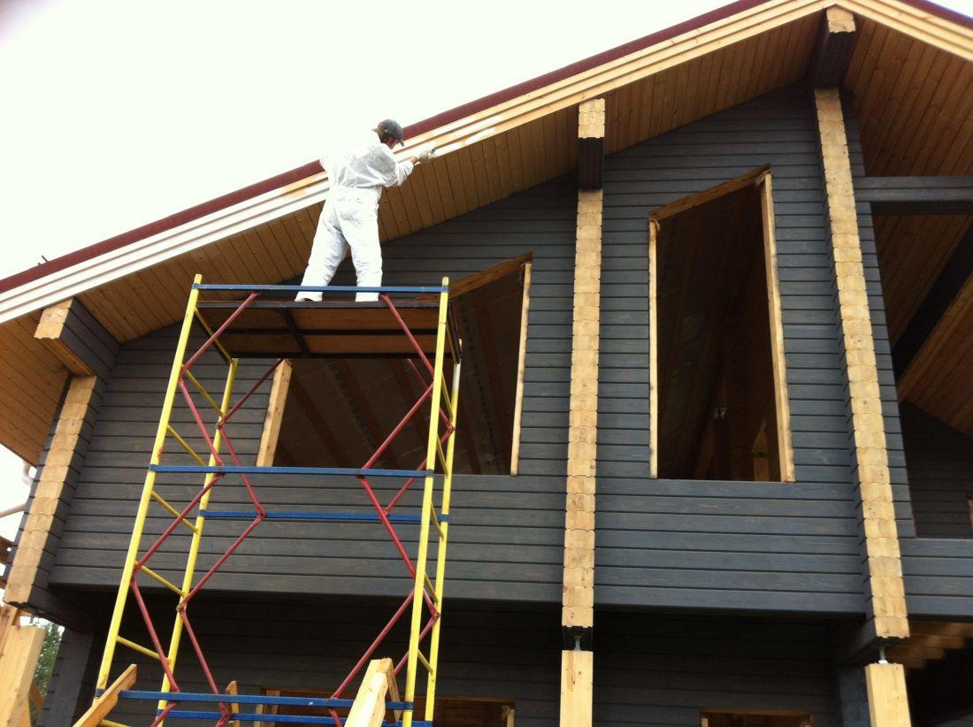 Окрашивание дома из бруса