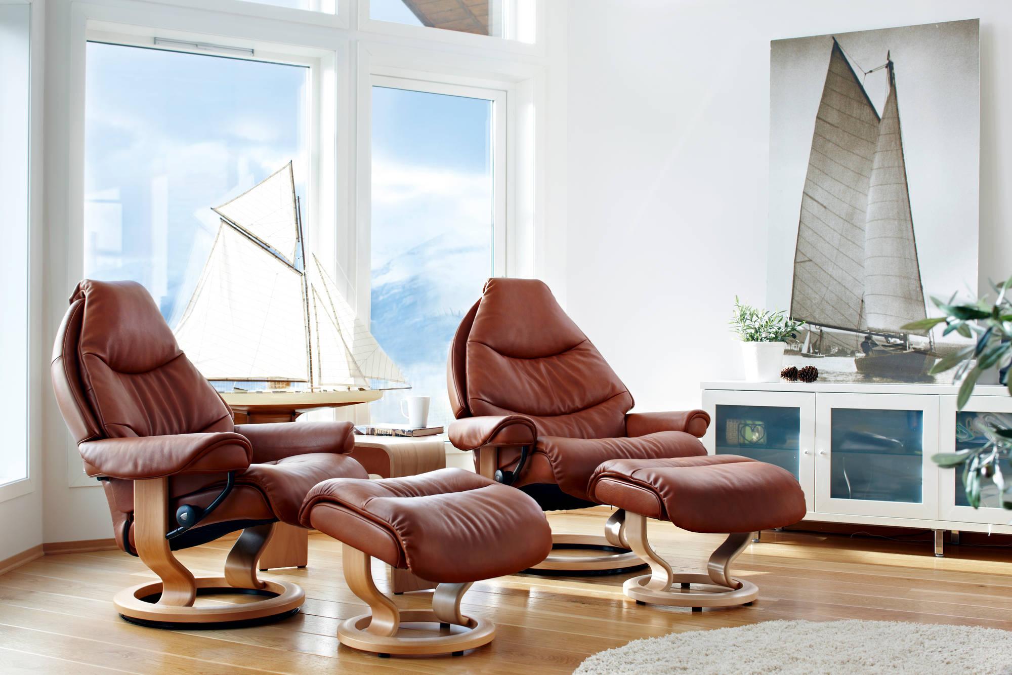 Кресло реклайнер из коричневой кожи