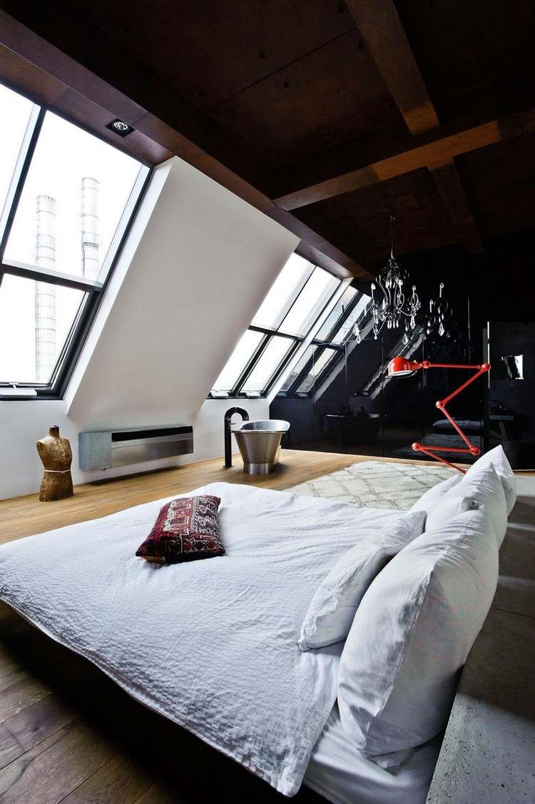 Кровать напротив окна в стиле лофт