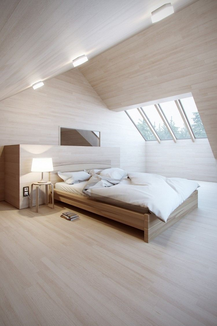 Кровать изголовьем к окну в спальне загородного дома