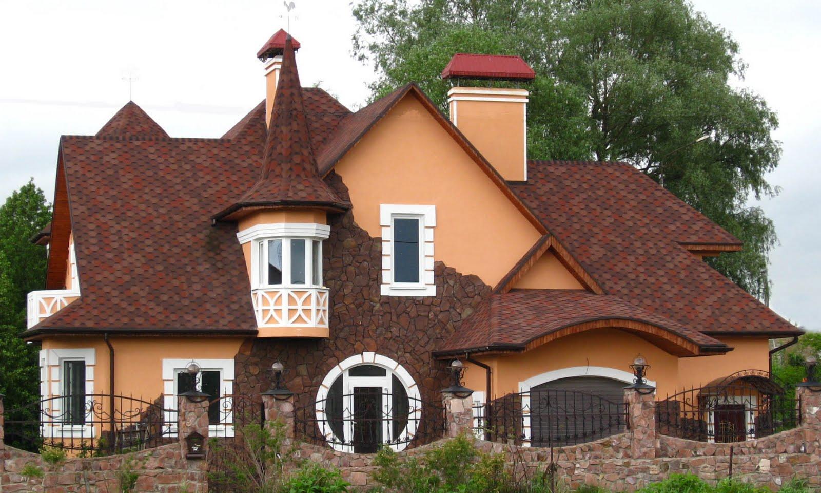 Вальмовая крыша большого дома