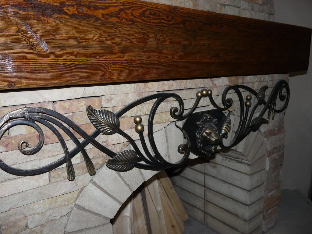 Декор камина ковкой
