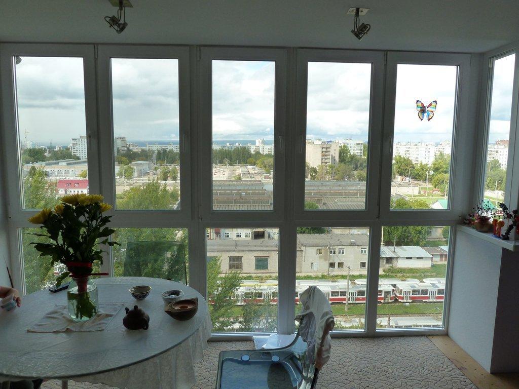 Панорамное остекление кухни с балконом