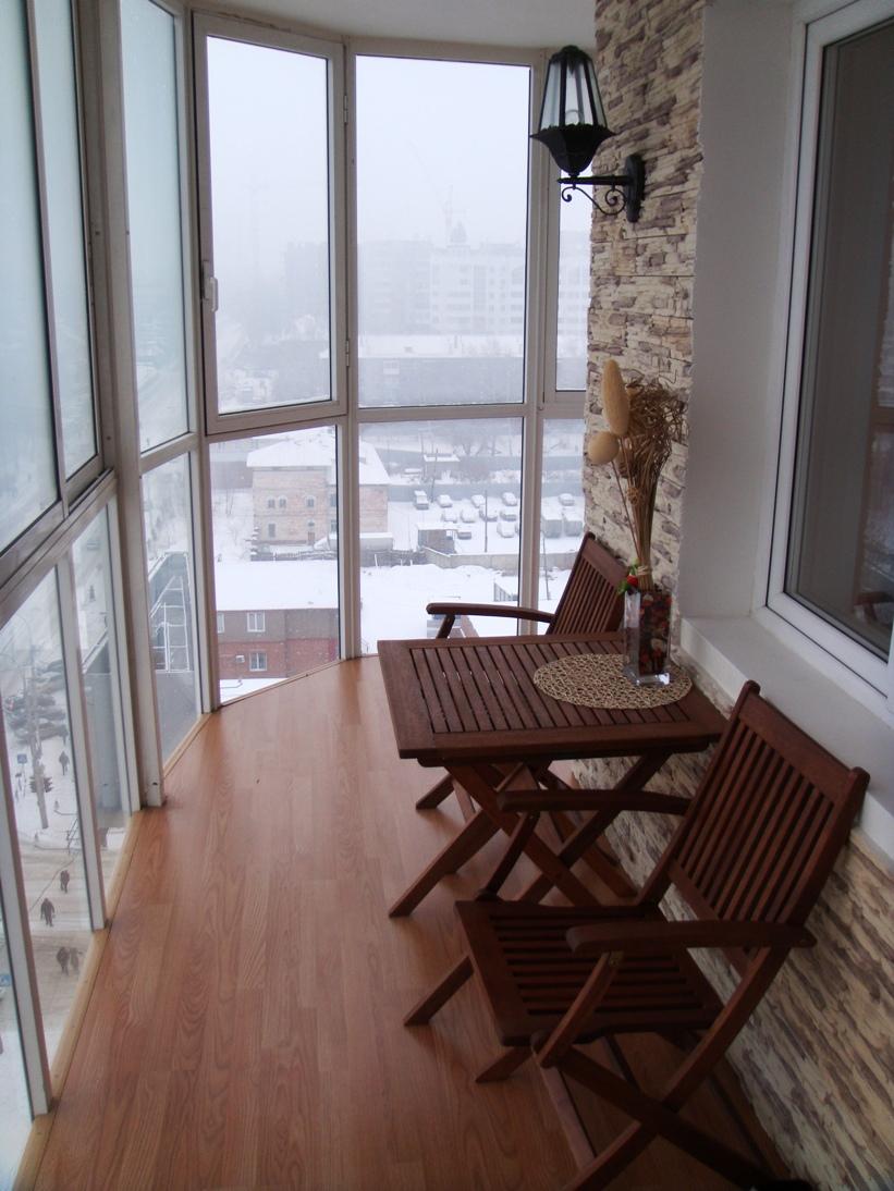 Полукруглый балкон с панорамными окнами