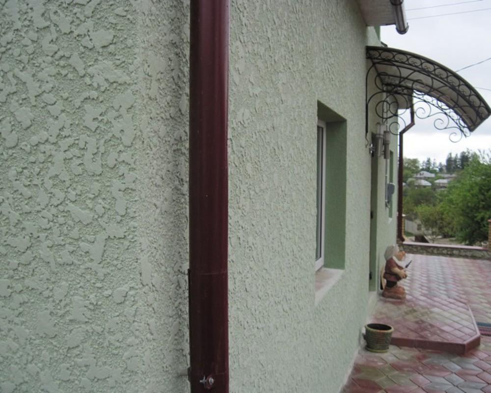 Штукатурка американка на стенах дома