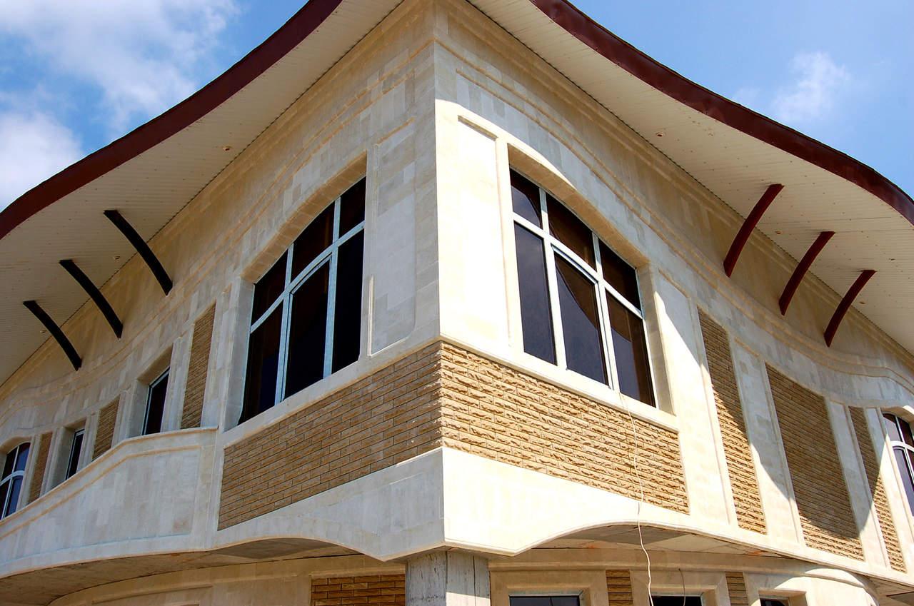 Облицовка фасада панелями под кирпич