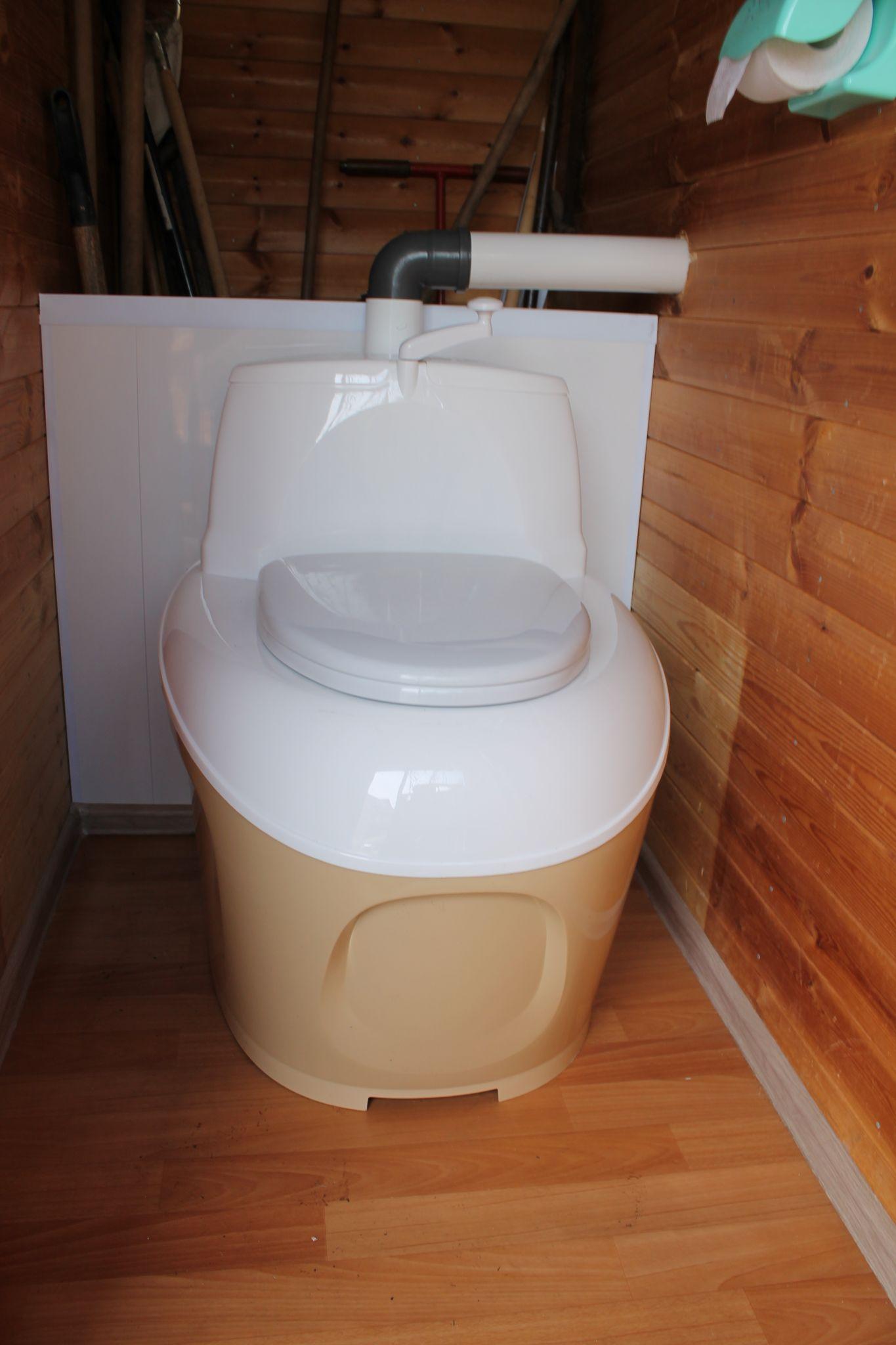 Белый торфяной биотуалет