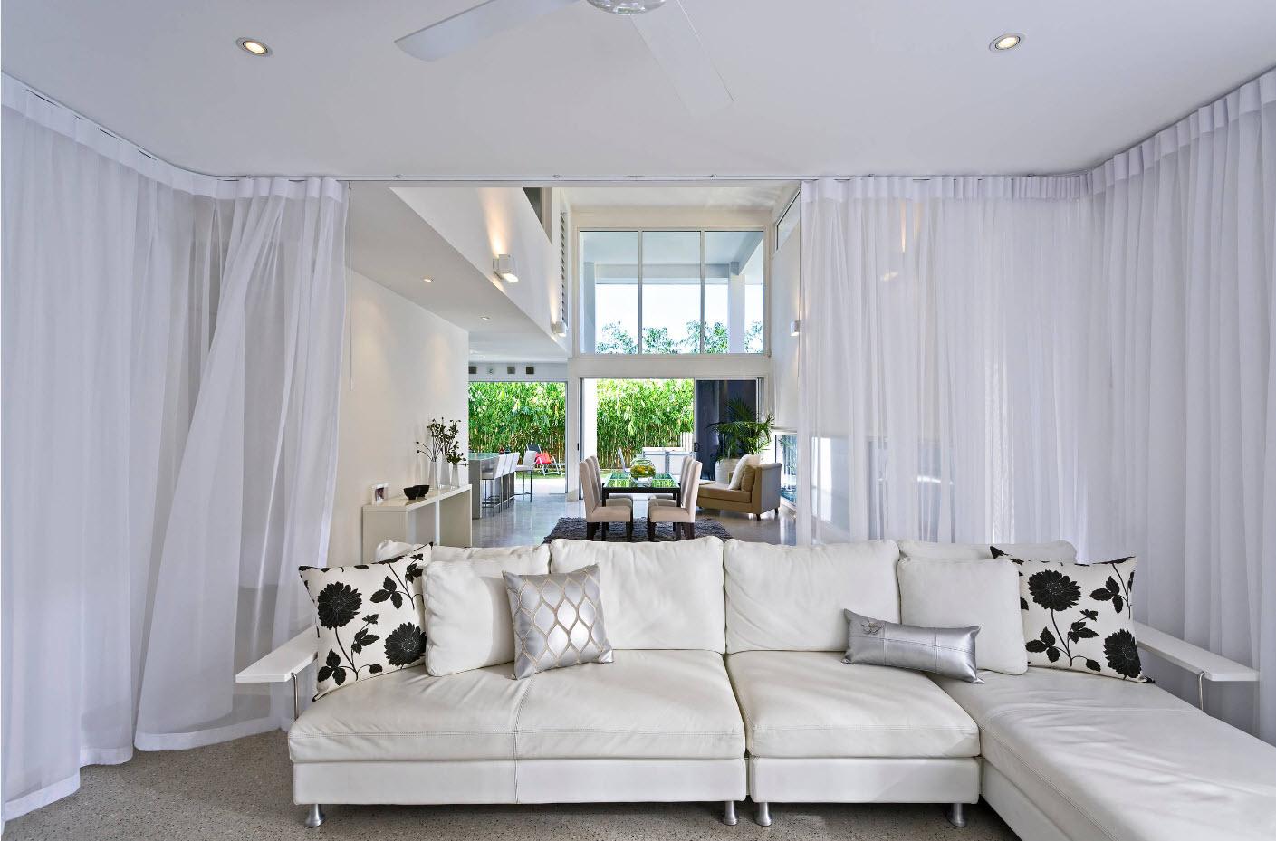 Тюль для гостиной в интерьере дома