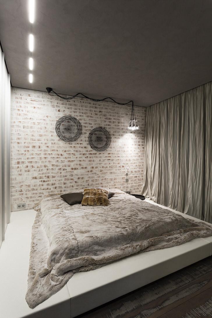 Кирпичная стена в спальне в стиле лофт