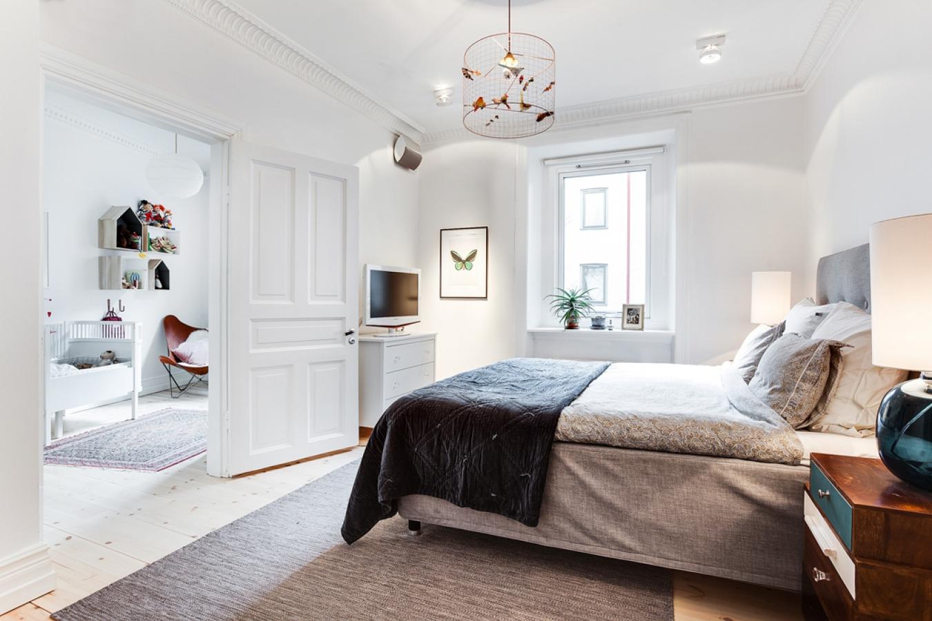 Спальня в скандинавском стиле в интерьере квартиры