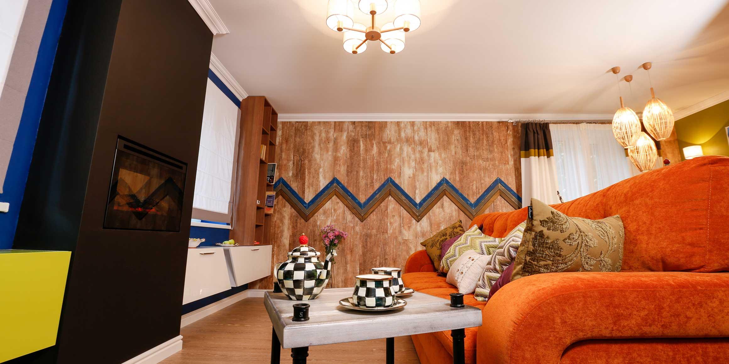 Оранжевый велюровый диван