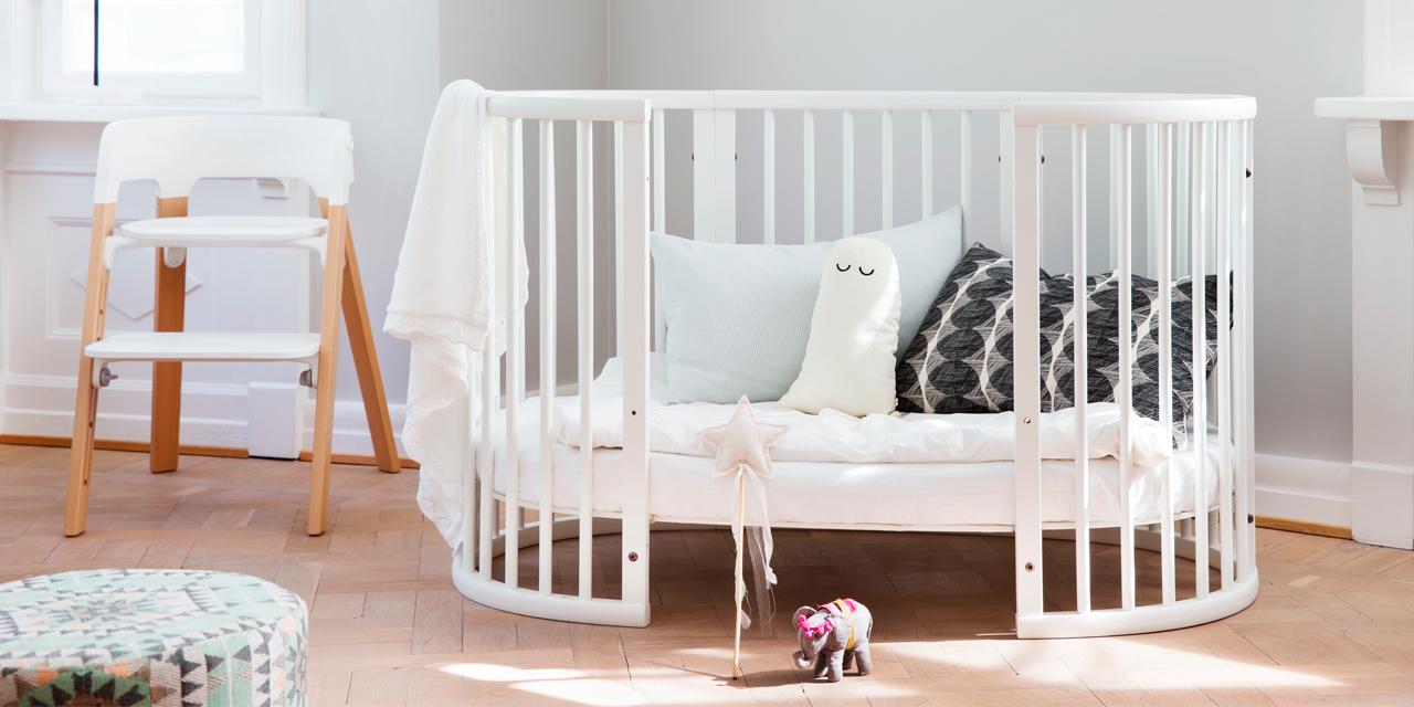 Овальная кровать с манежем