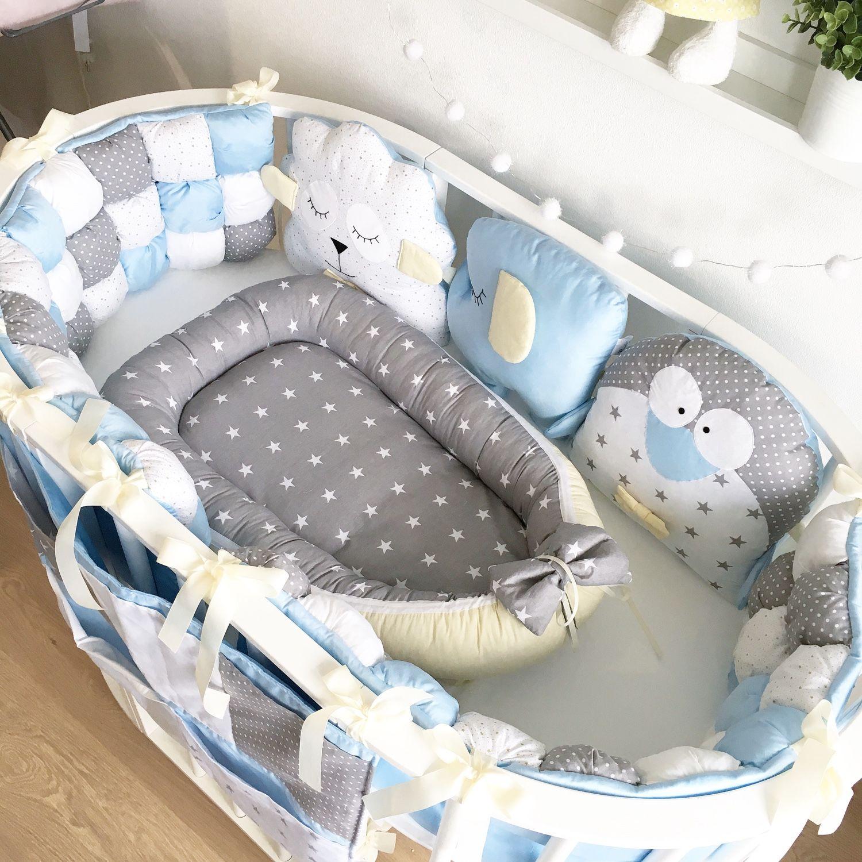 Овальная кровать для новорожденного
