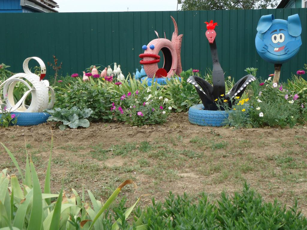 Скульптуры из шин для сада