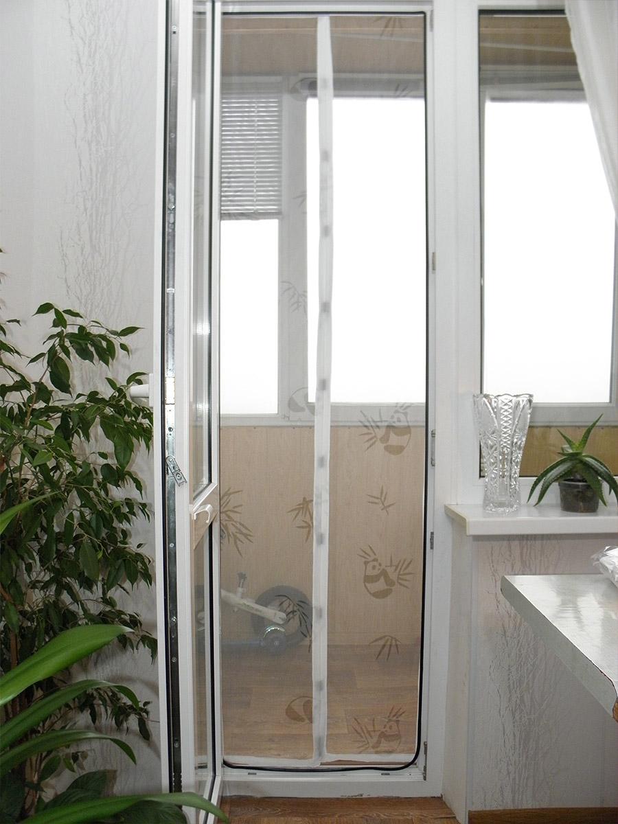 Штора сетка на балконной двери