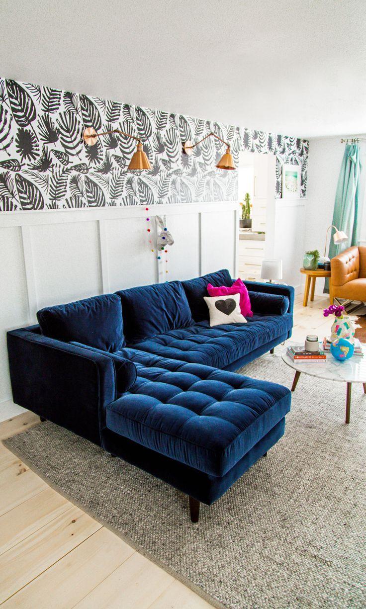 Синий диван с оттоманкой