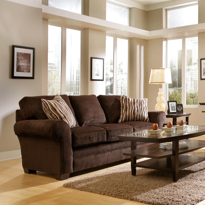 Коричневый вельветовый диван